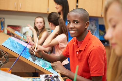Teen in art class
