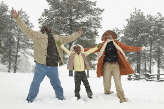 Black Family having fun in the snow