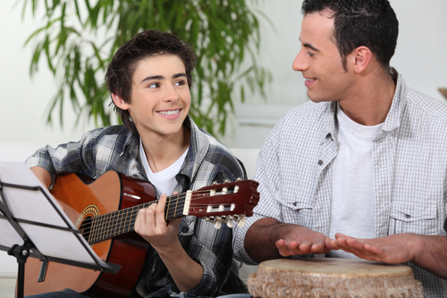 Father and Son Playing Music