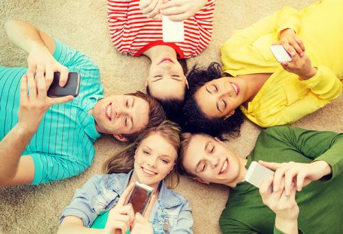 Teens on their smartphones