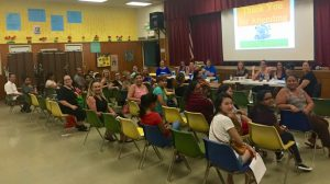 A diverse group of parents gather to learn how to support their children's education at the Paularino Elementary School PTA meeting in Costa Mesa, CA.