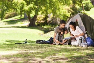 A joyful family camping and reading