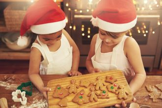 Girls making cookies for Santa