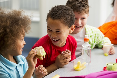 Young Students Finding Lunchtime Funny