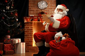 Happy Santa Claus sitting at home in Northpole