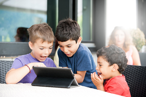 Boys playing on a tablet
