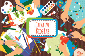 Creative kids lab, top view table with creative kids hands. Cutting paper, painting and sketching.