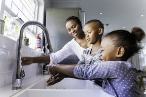 Healthy Habits - Family washing their hands together.