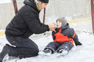 Asthma, Allergies flare ups: A family playing at the skating rink in winter.