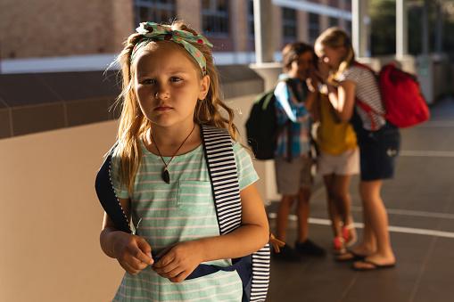 School friends bullying a sad