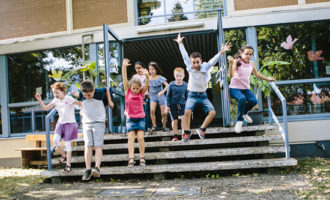 Case for recess - Elementary school students run out of school to Schoolyard