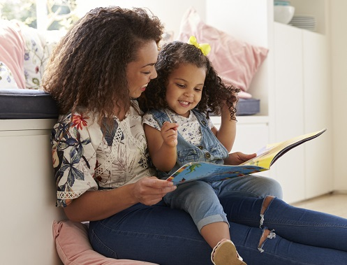 mom reading to child to help social and emotional learning