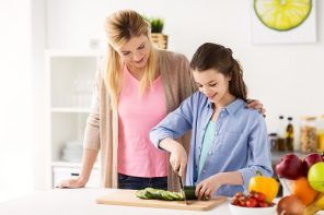Mom teaching teen daughter to cook