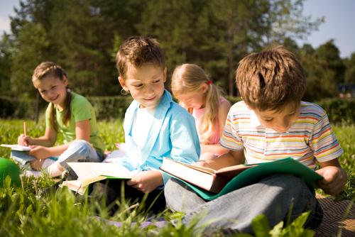 Kids Reading Outside
