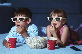 kids watching movie at home