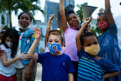diverse children protesting against racism