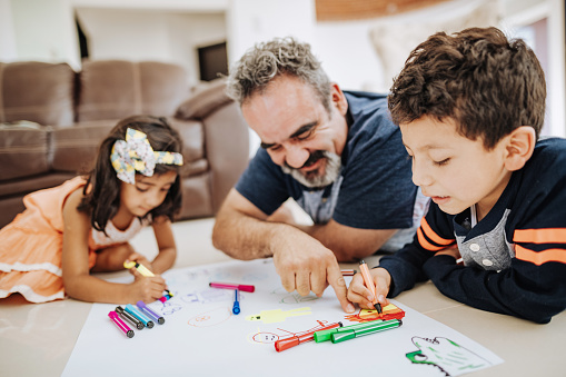 Building Social Emotional Skills: Latino family enjoys weekend together with grandparents and children.