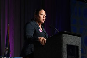 National PTA President Anna King Profile. She is at the podium speaking at convention.